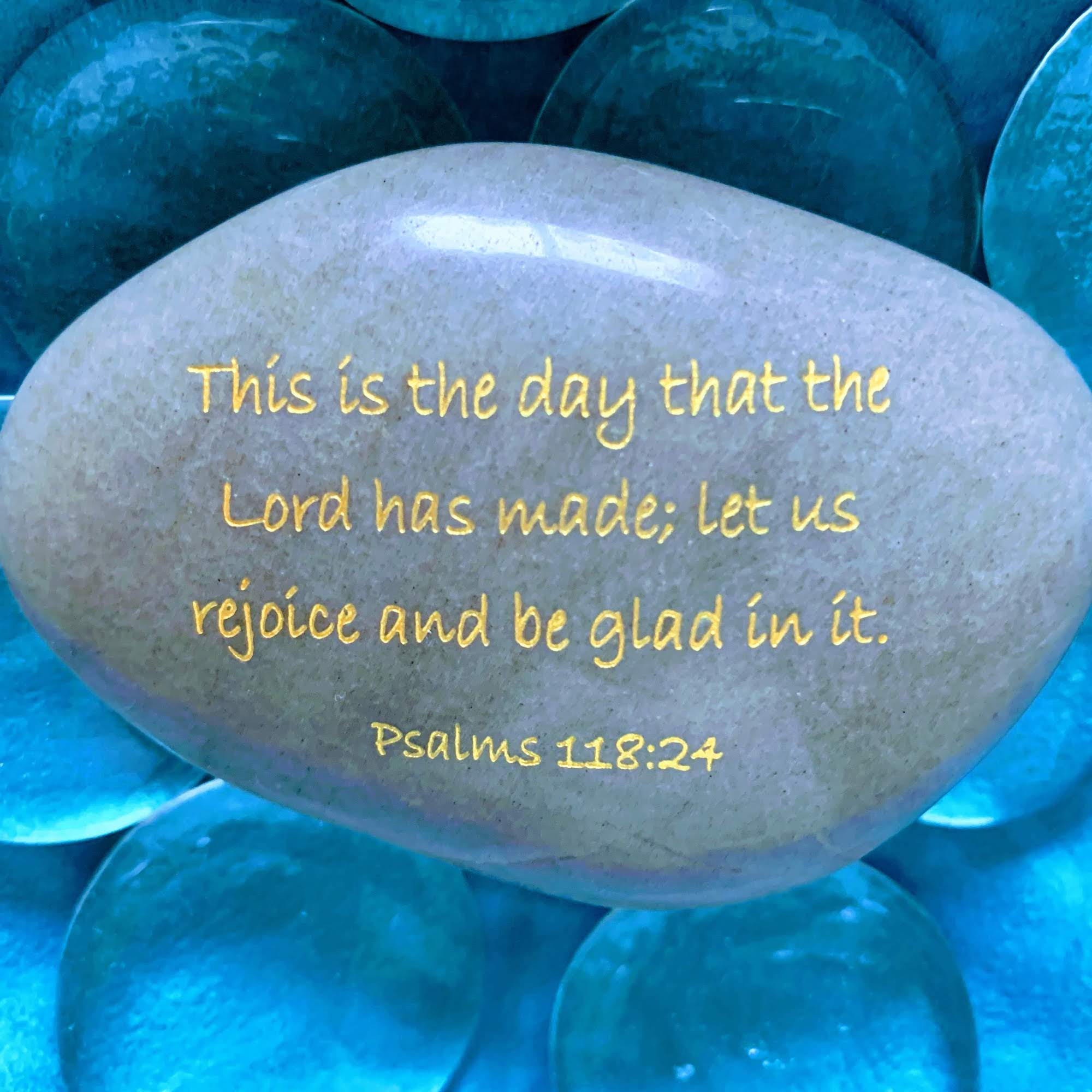 A rock inscribed with the verse: This is the day that the Lord has made. I will rejoice and be glad in it.